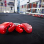Close-up of red gloves in boxing ring